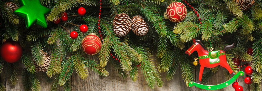 tree branches and ornaments on top of wood board