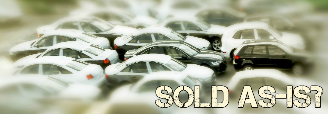 cars clustered together with focal point centered and blurred out on the edges with sold as-is text