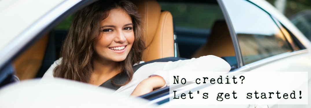 woman in driver seat of car looking out and smiling at camera with text No credit Let's get started overlaid