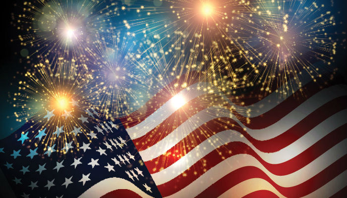 American flag with fireworks above it