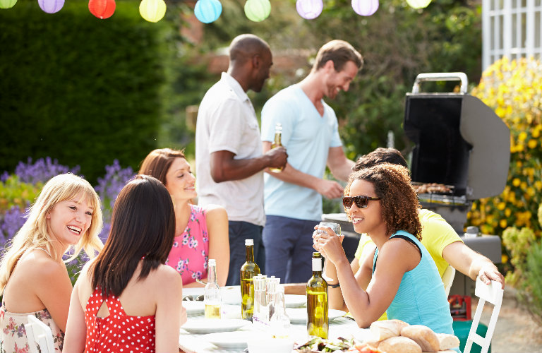 group of friends at a backyard barbecue