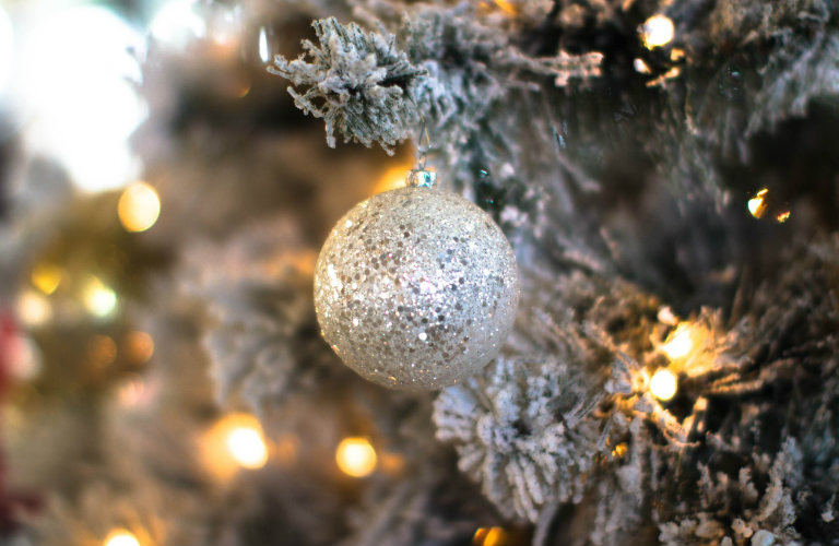 closeup of silver ornament on Christmas tree
