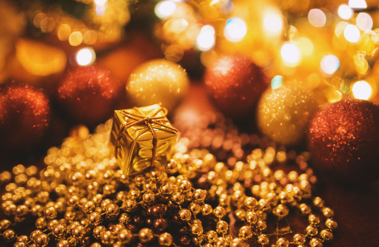 gold-hued Christmas ornaments and decorations