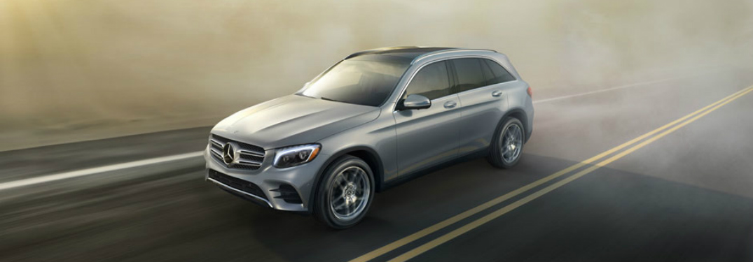 silver Mercedes-Benz GLC driving on foggy highway