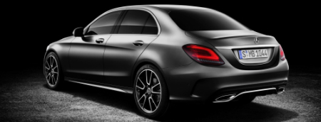 rear-side view of gray silver 2019 Mercedes-Benz C-Class on black background