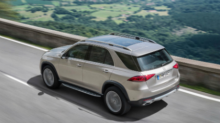 overhead and side view of 2020 gle driving on a mountain road