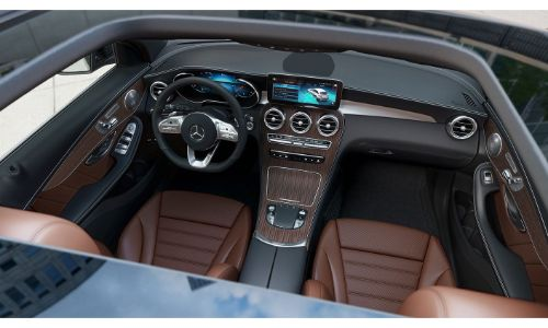 2020 Mercedes-Benz GLC SUV interior shot from through sunroof showing brown interior and screens on