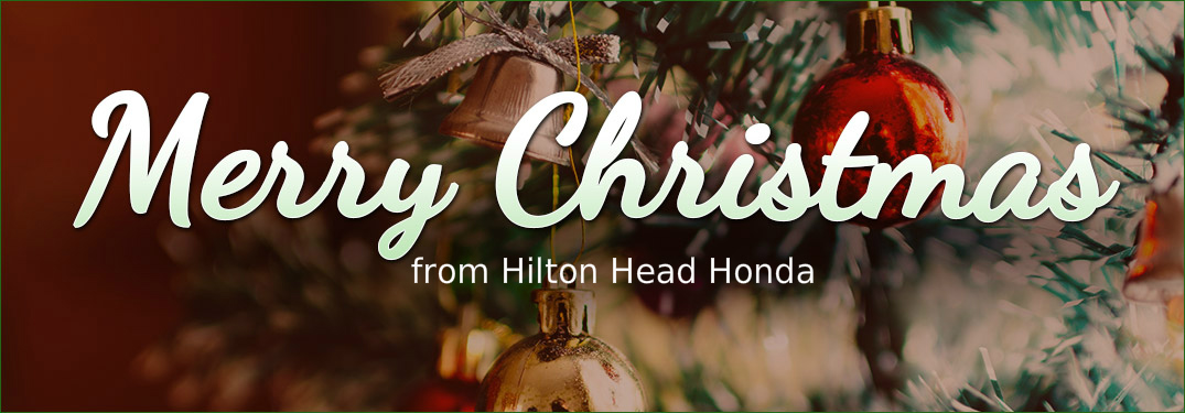 text saying Merry Christmas from Hilton Head Honda with Christmas tree in background