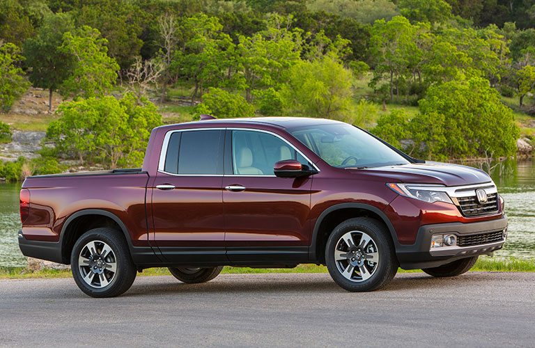 dark red 2018 Honda Ridgeline parked