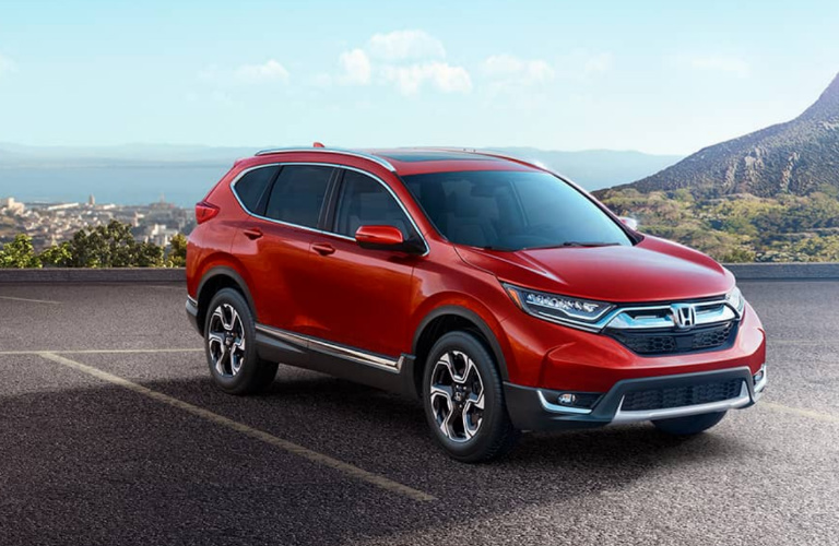 red 2018 Honda CR-V parked on cliff