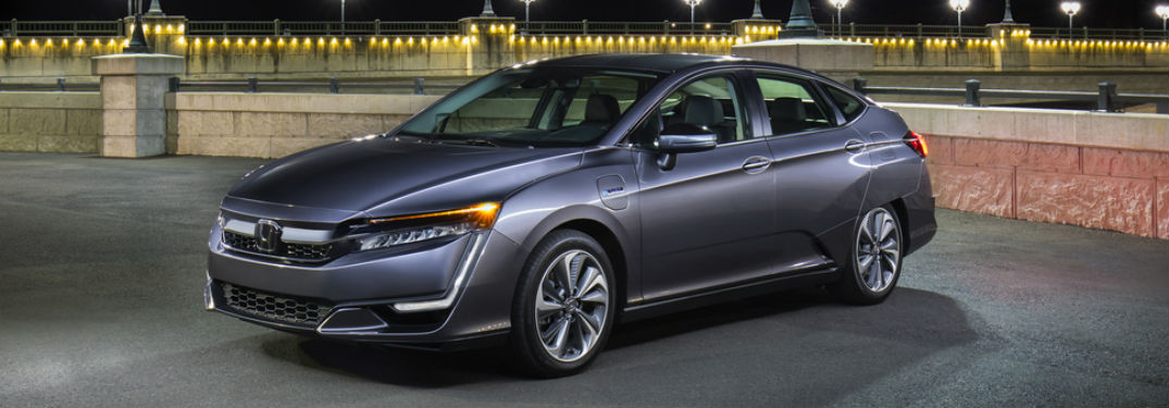 left side angled view of parked gray honda clarity