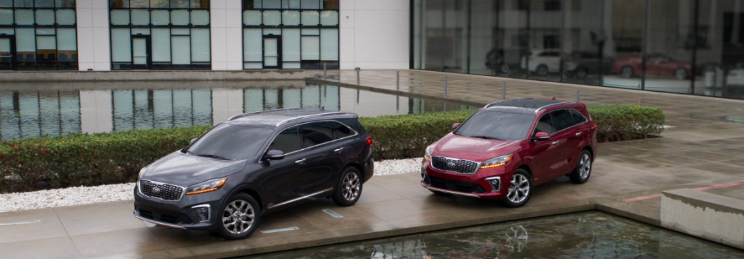silver and red Kia Sorento models parked next to pool