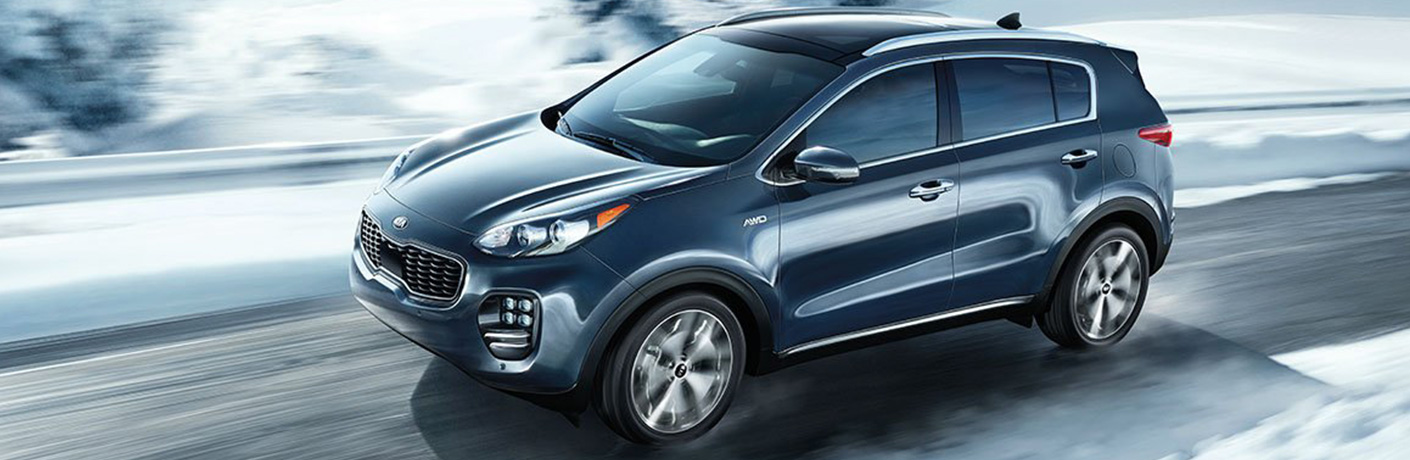 2020 Kia Sportage driving down wintry road
