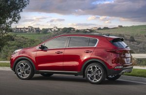 2020 KIia Sportage driving down rural road