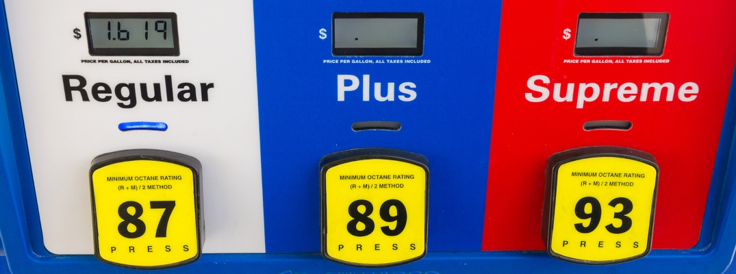 A photo of the different grades of gasoline a customer may choose at a gas station.