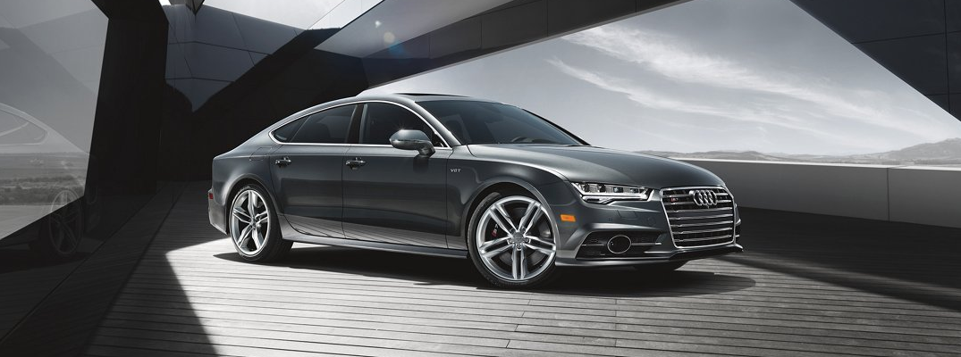 2018 Audi S7 exterior side shot with gray metallic color paint job parked in a skylight patio parked on wood paneling