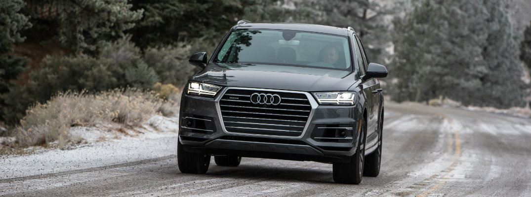 2018 Audi Q7 driving on a snow-covered road