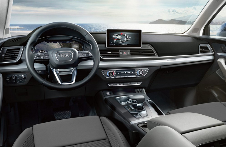 Front two seats and steering wheel of 2019 Audi Q5
