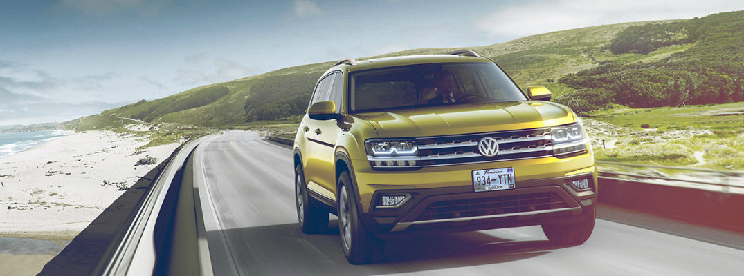 2018 vw atlas driving down the road hansel volkswagen hansel volkswagen
