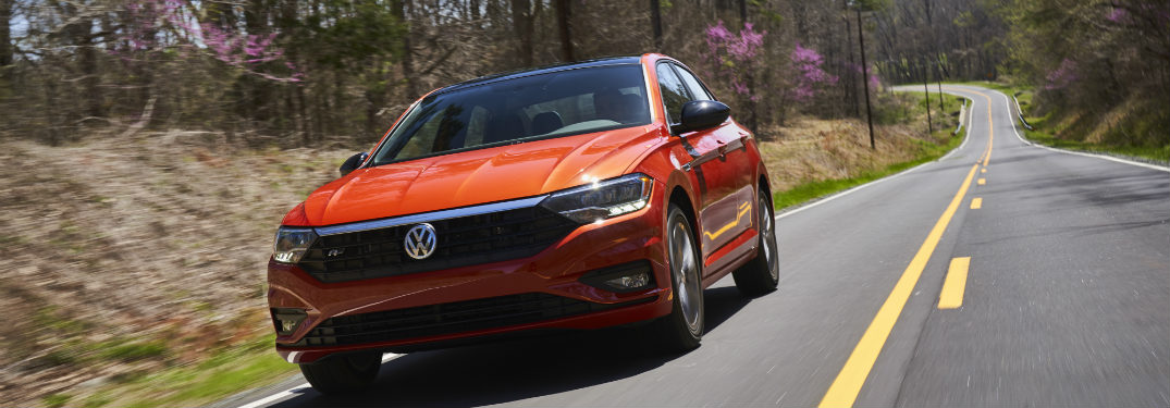 2019 Volkswagen Jetta driving down a road