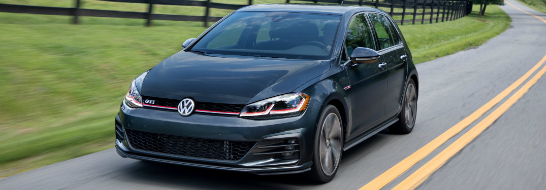 2018 Volkswagen Golf GTI driving down a rural road