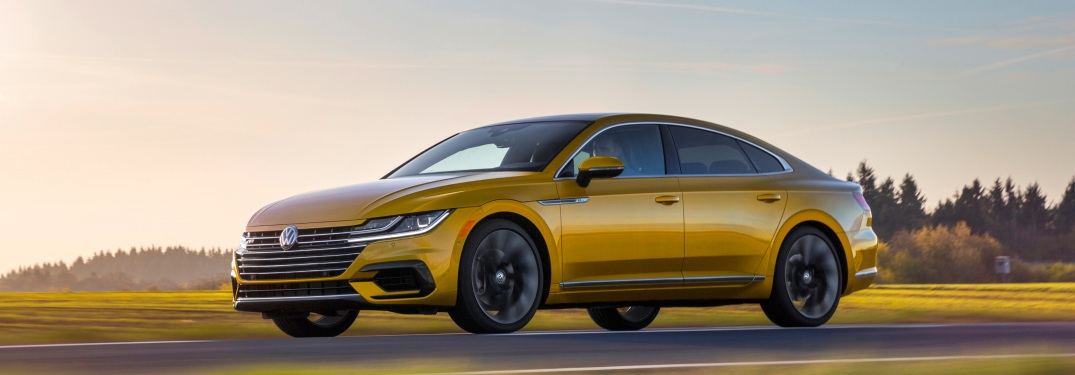 2019 Volkswagen Arteon driving on a road at sunset