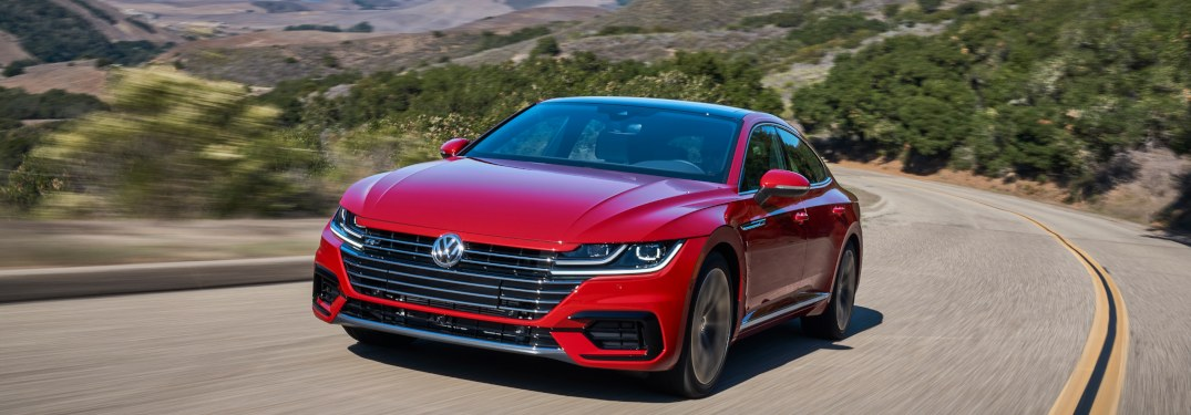 2019 Volkswagen Arteon driving down a curving road