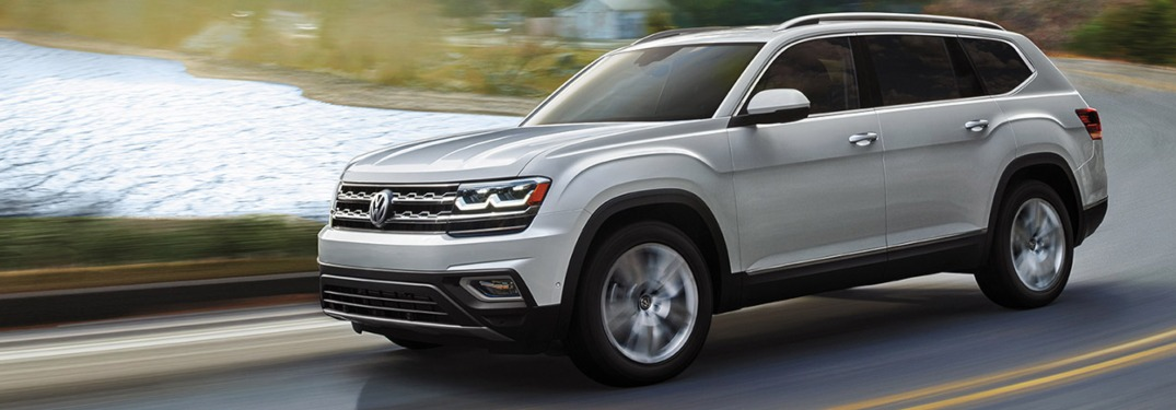 2019 Volkswagen Atlas driving by a lake