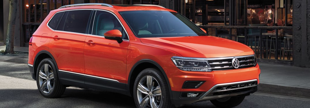 2019 Volkswagen Tiguan parked on front of a shop