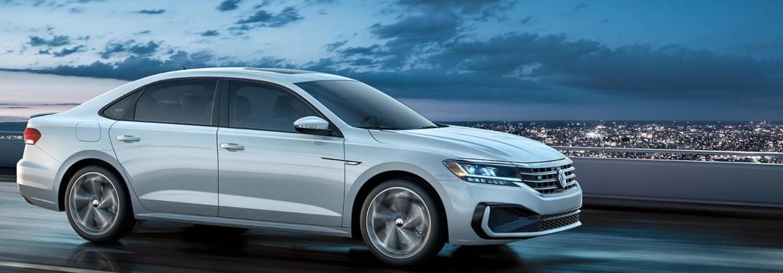 2020 Volkswagen Passat driving down a highway at night