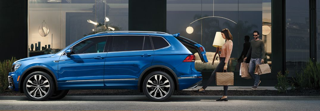 A woman putting cargo inside a 2020 Volkswagen Tiguan
