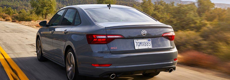 2020 Volkswagen Jetta GLI driving down a rural road