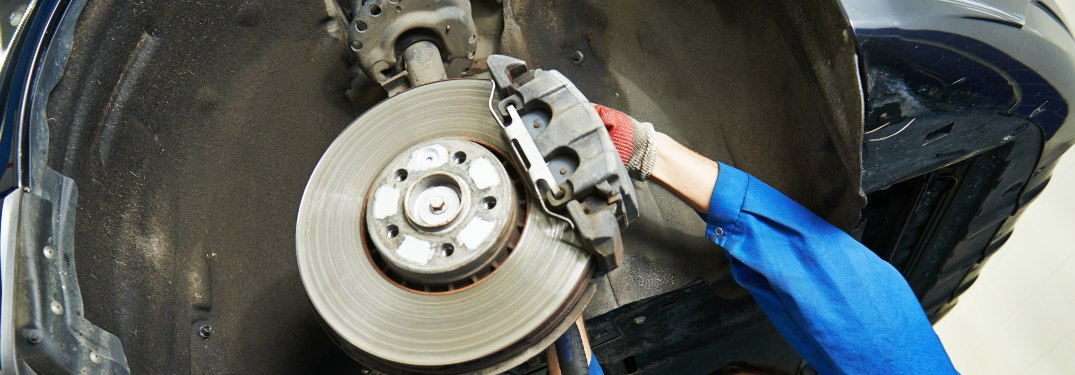 Close up on a mechanic working on brakes