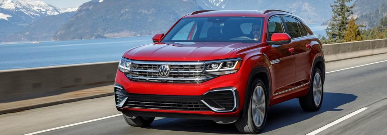 2021 Volkswagen Atlas Cross Sport driving down a street