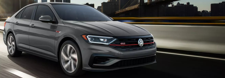 2021 Volkswagen Jetta GLI driving down a city street