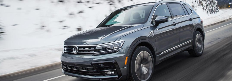 2021 Volkswagen Tiguan driving down a winter road