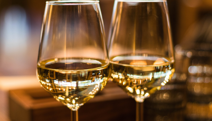 Close-up on two wine glasses