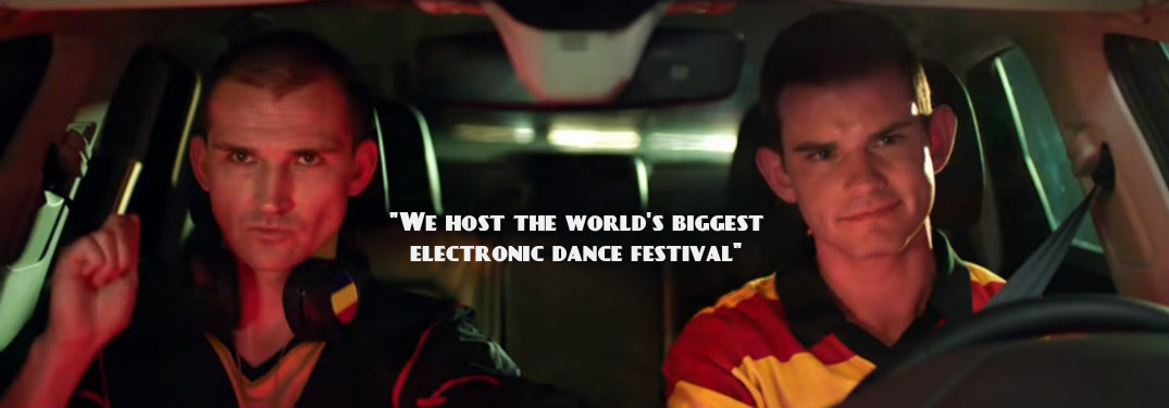 Men in Belgium Soccer Jerseys sitting in vehicle with quote about Belgium having the biggest electronic dance festival