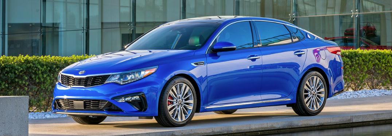 blue 2019 Kia Optima parked