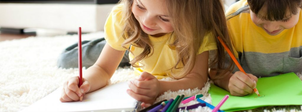 Kids drawing on paper at home