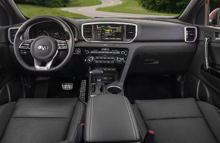 Steering wheel, gauges, and touchscreen in 2021 Kia Sportage