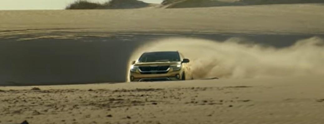 Yellow 2021 Kia Seltos driving through a desert