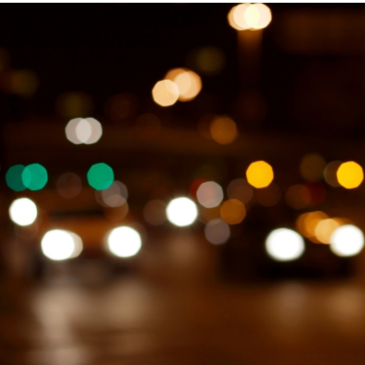 blurred picture of vehicle and traffic lights