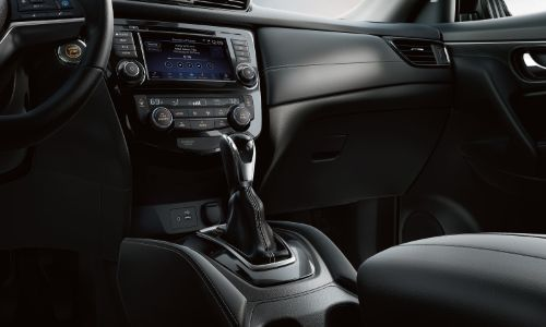 2020 Nissan Rogue close up shot of shifter and lower dashboard