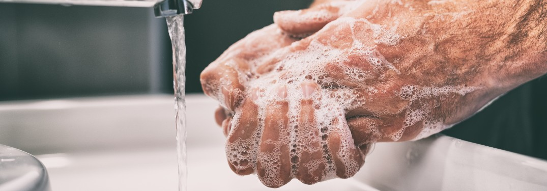 hands washing coronavirus pandemic water soap sink