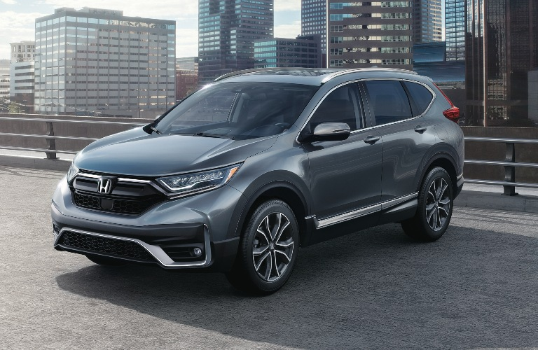 2020 Honda CR-V parked in front of skyscrapers