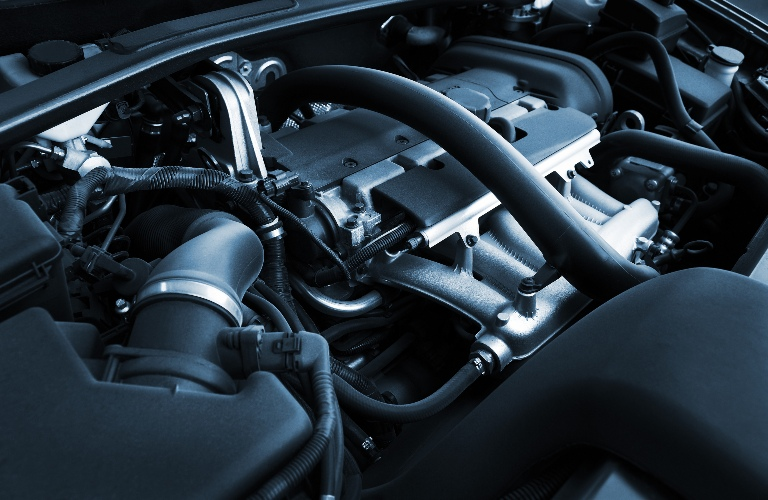 An engine under the hood of a vehicle