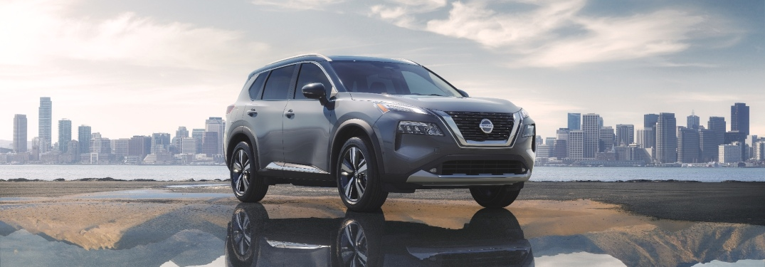 2021 Nissan Rogue with a big city in the background