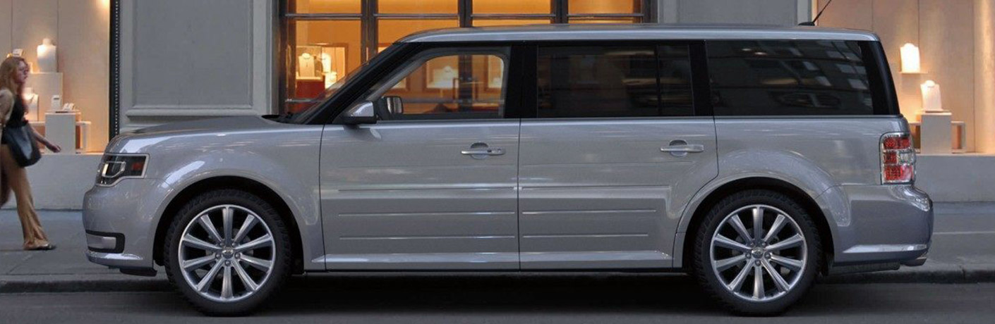 side view of silver 2019 ford flex parked
