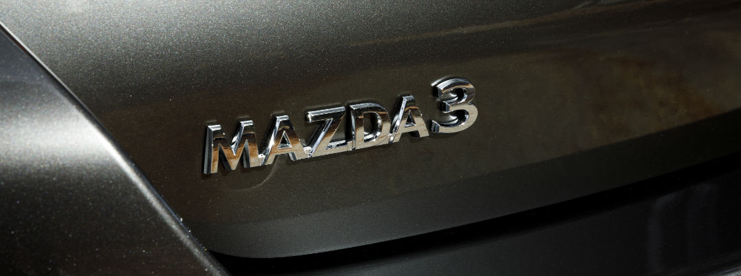 A close up photo of the Mazda3 badge used by the 2019 Mazda3.